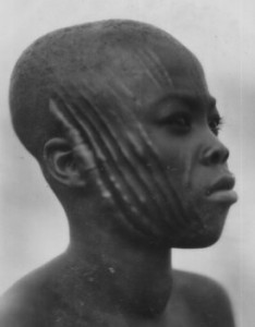 Scarification is a rite of passage in several African traditional cultures. This image is believed to be in the public domain.